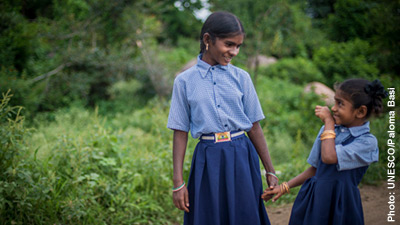 Two indian sisters in school uniform